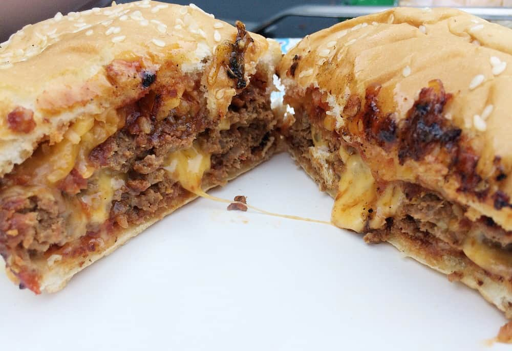 Turkey sloppy joes burgers are cut in half with cheese