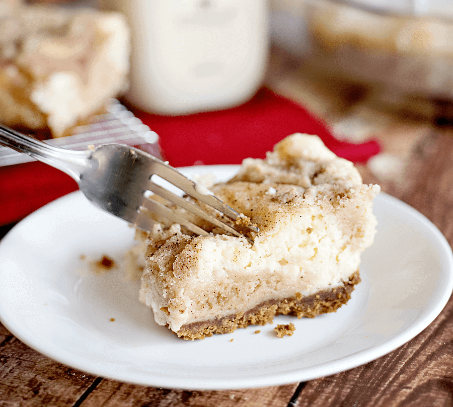keto cheesecake bars with fork slicing into cake