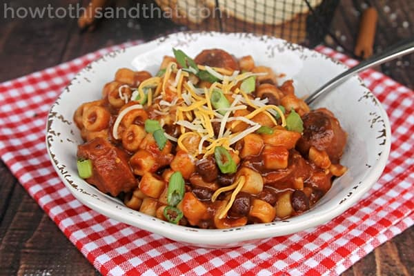 This spicy sausage, bean and pasta soup is the PERFECT weeknight dinner! It's so easy to make and is full of savory spicy delicious flavor! If you're looking for a delicious bean and sausage soup slow cooker recipe - this is the one!