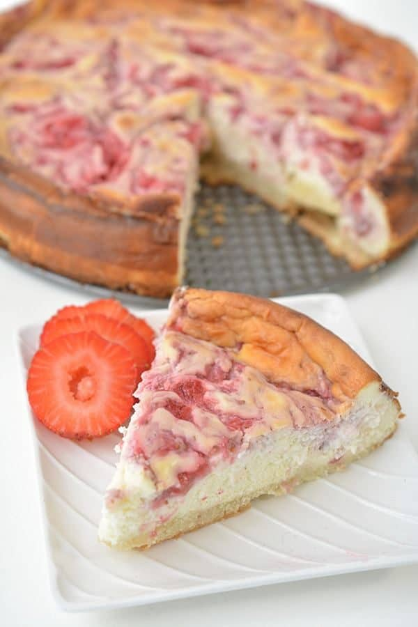 This keto strawberry swirl cheesecake is seriously THE BEST strawberry cheesecake! You can't even tell it's keto so it's perfect for parties. This keto cheesecake is sweet, moist, and full of strawberry flavor. If you're looking for a yummy keto strawberry dessert, you will LOVE this homemade strawberry cheesecake recipe. Just follow the easy step by step directions to make your very own.